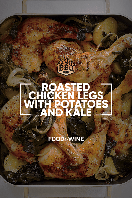 Roasted Chicken Legs with potatoes and kale in a baking dish