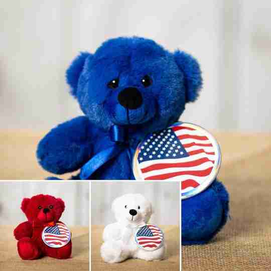 Red, white and blue bears sporting a button with the American flag on them.