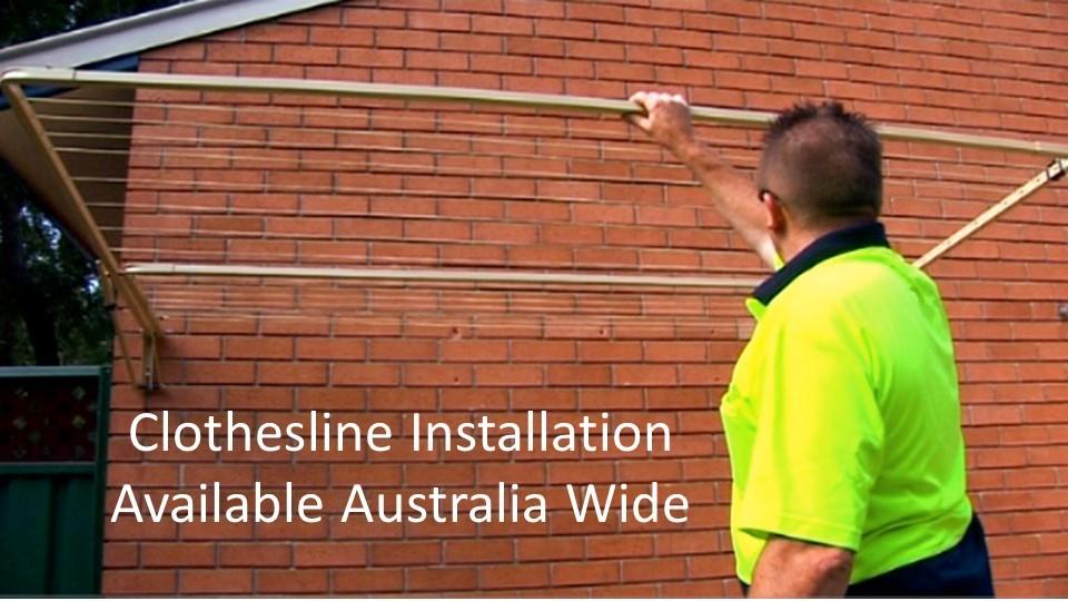 120cm wide clothesline installation service showing clothesline installer with clothesline installed to brick wall