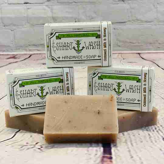 picture of 3 bars of tan natural handmade soap bars on a wood background