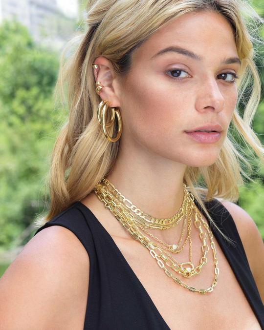 A model wearing Adina's necklaces and earrings