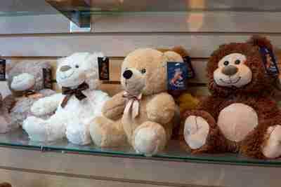Bears on a glass shelf.