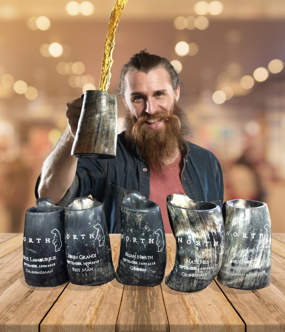 alehorn guy holding a large viking drinking horn tankard