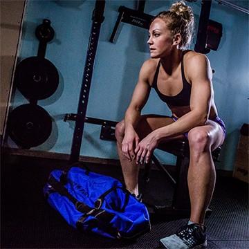 Bodyweight training woman in garage gym