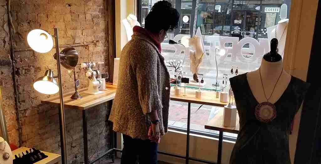 A customer shops inside Junebug's Pop-Up Jewelry Boutique