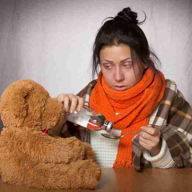 Sick woman taking medicine