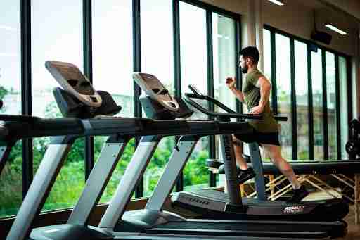 man doing cardio running on treadmill changing pace
