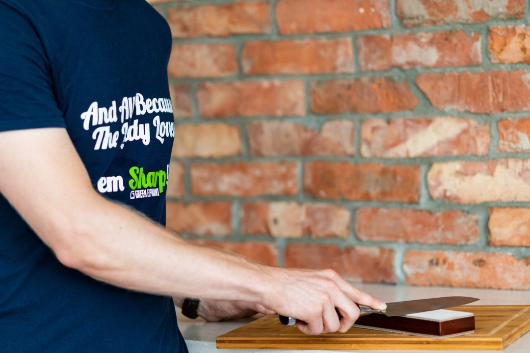 A man using leather strop by Green Elephant Kitchen