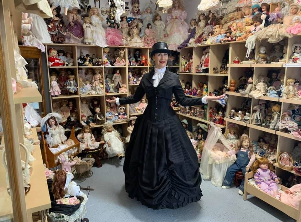 Silvia in full Gallery Serpentine pinstripe corset gown with bolero jacket at her Doll Museum at Monte Cristo Junee