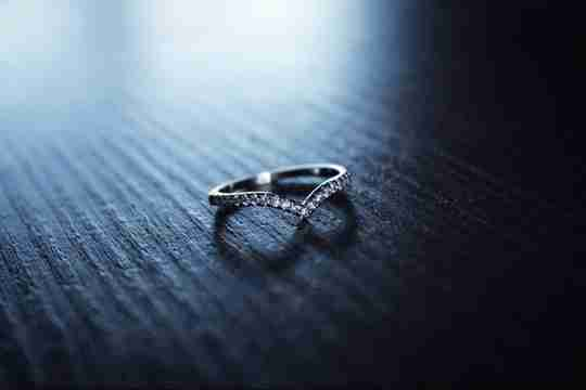 Heart-shaped ring on a blue surface