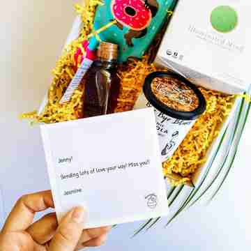 A box full of gifts with a personalized note
