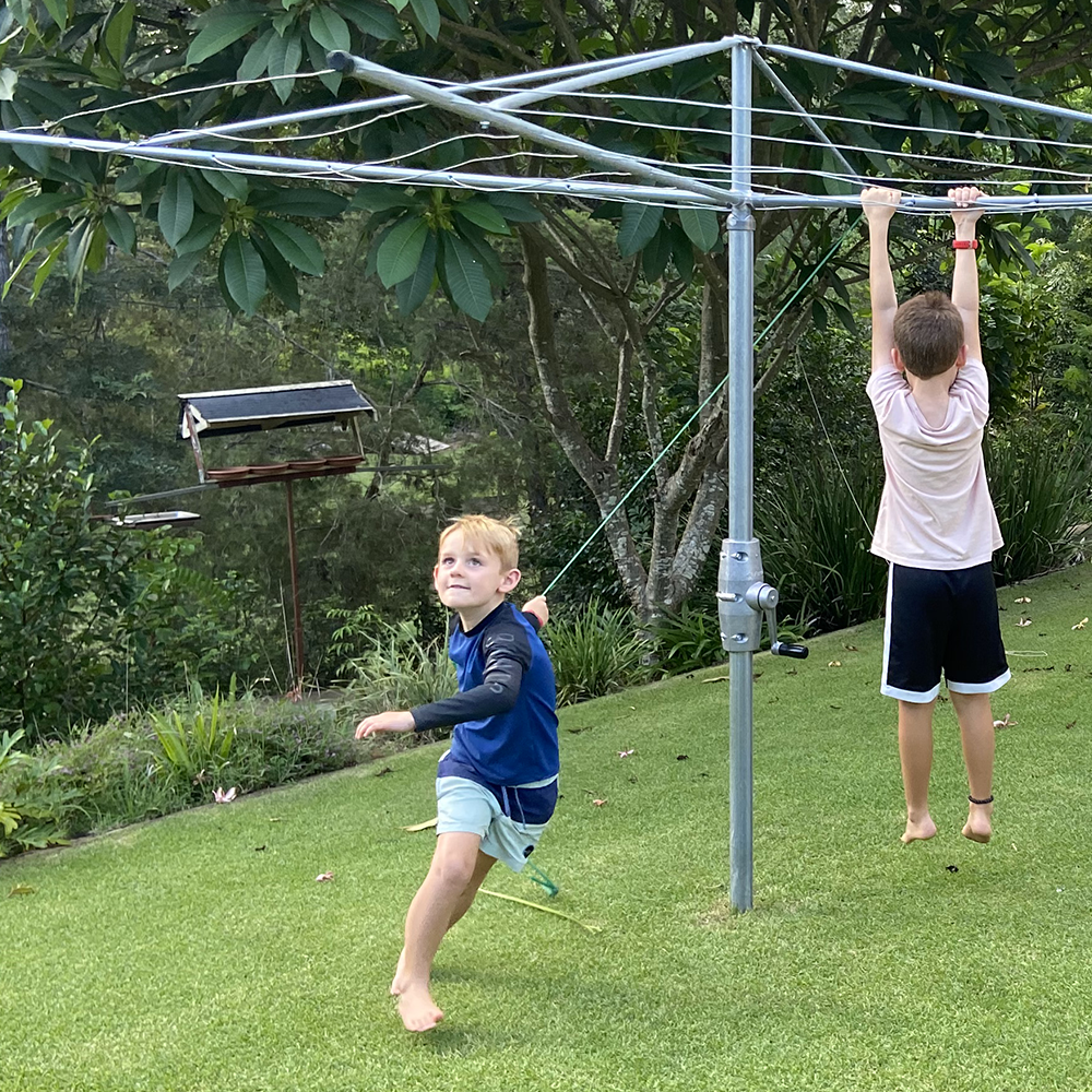 kids playing on an Austral clothesline in Sydney