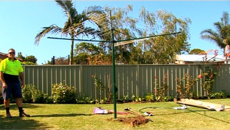 austral rotary clothesline supply and installation with clothesline installed into grass area