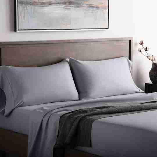 Pretty bedroom with mattress and pillows