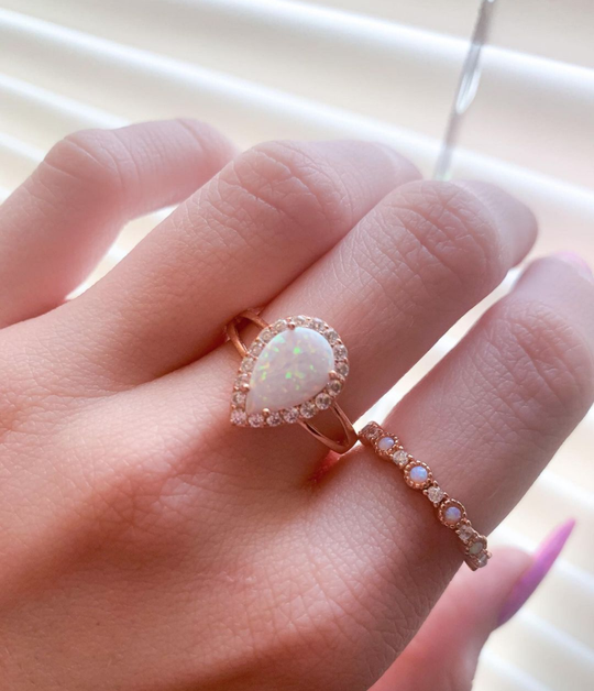 A woman wearing Blush and Bar opal rings
