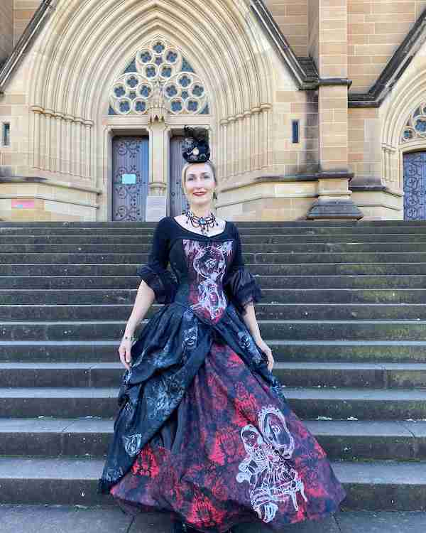 Silvia from The Haunted Dolls Museum at Monte Cristo, Junee, NSW wearing her custom artwork corset gown featuring her images of her favourite dolls