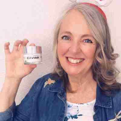 Older Woman Holding Caviar Face Cream