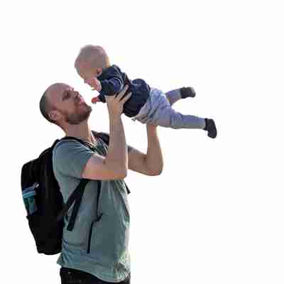 dad with baby carrying baby bag