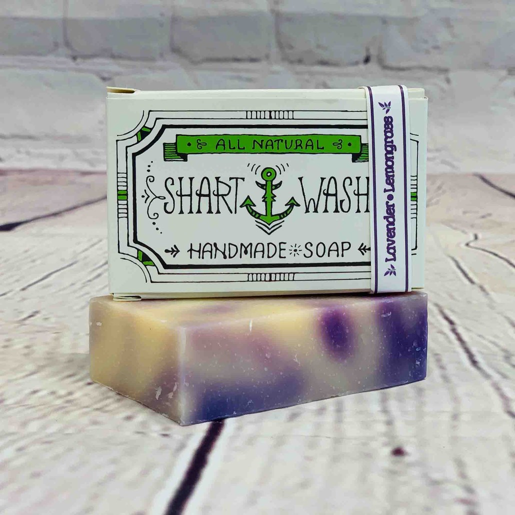 Picture of Shart Wash Handmade Soap Bars. Purple and white Lavender lemongrass scent on a wood background