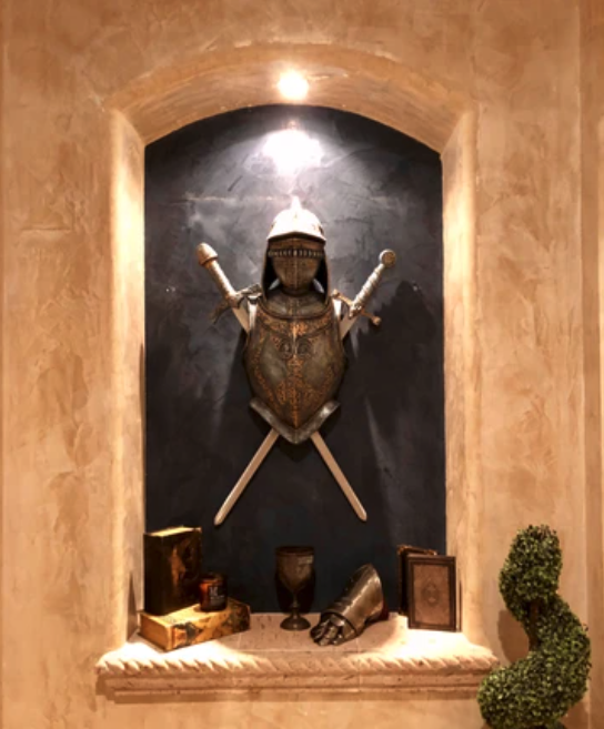 knight's armour and sword displayed in leah's home