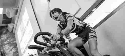high intensity interval training woman on bike cycling