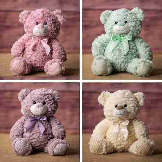 Four bears in pastel colors, pink, green, purple and yellow. The fur's texture is wrinkly.