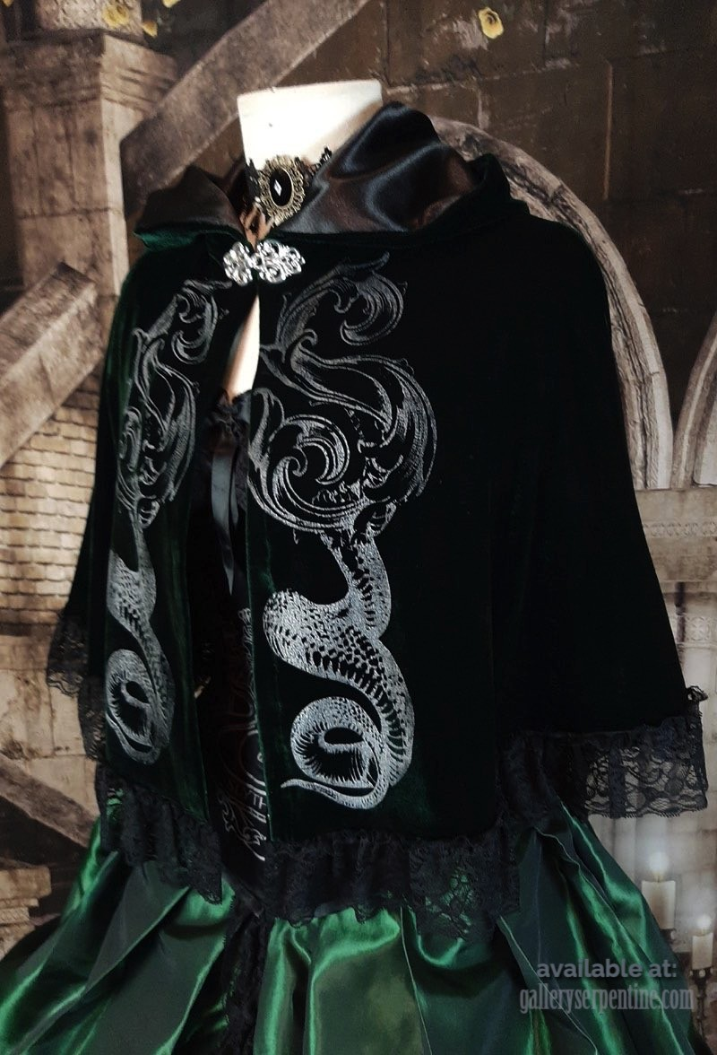 close up on the front of the Deluxe Slythering Cape in dark green velvet with unique screen printing, made in Australia