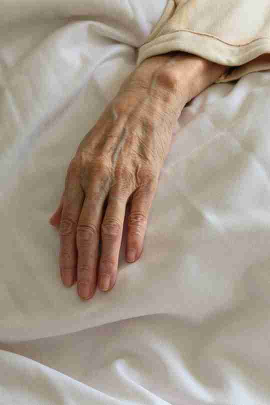 A elderly woman's hand
