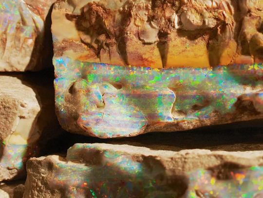 Opal strata in a layer of rock