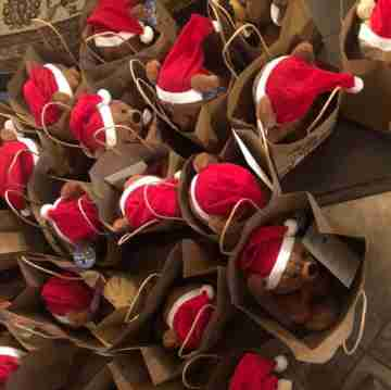 Teddy bear Santas in a bag.