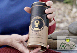a lady holding a Kansa Wand cylinder