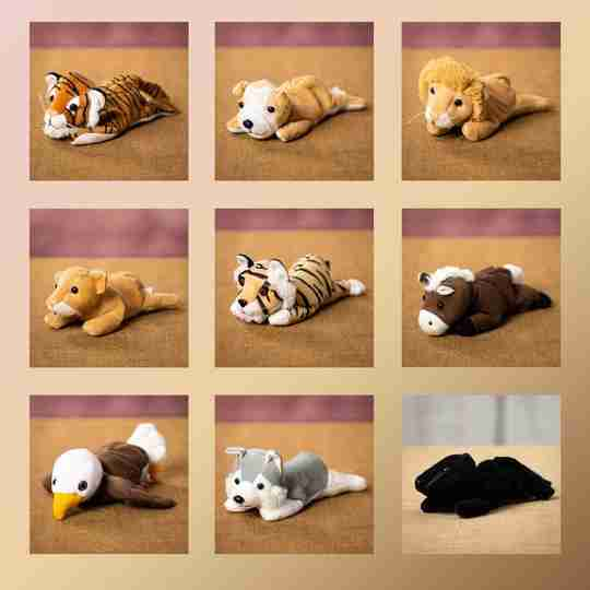 An assortment of laying plush animals