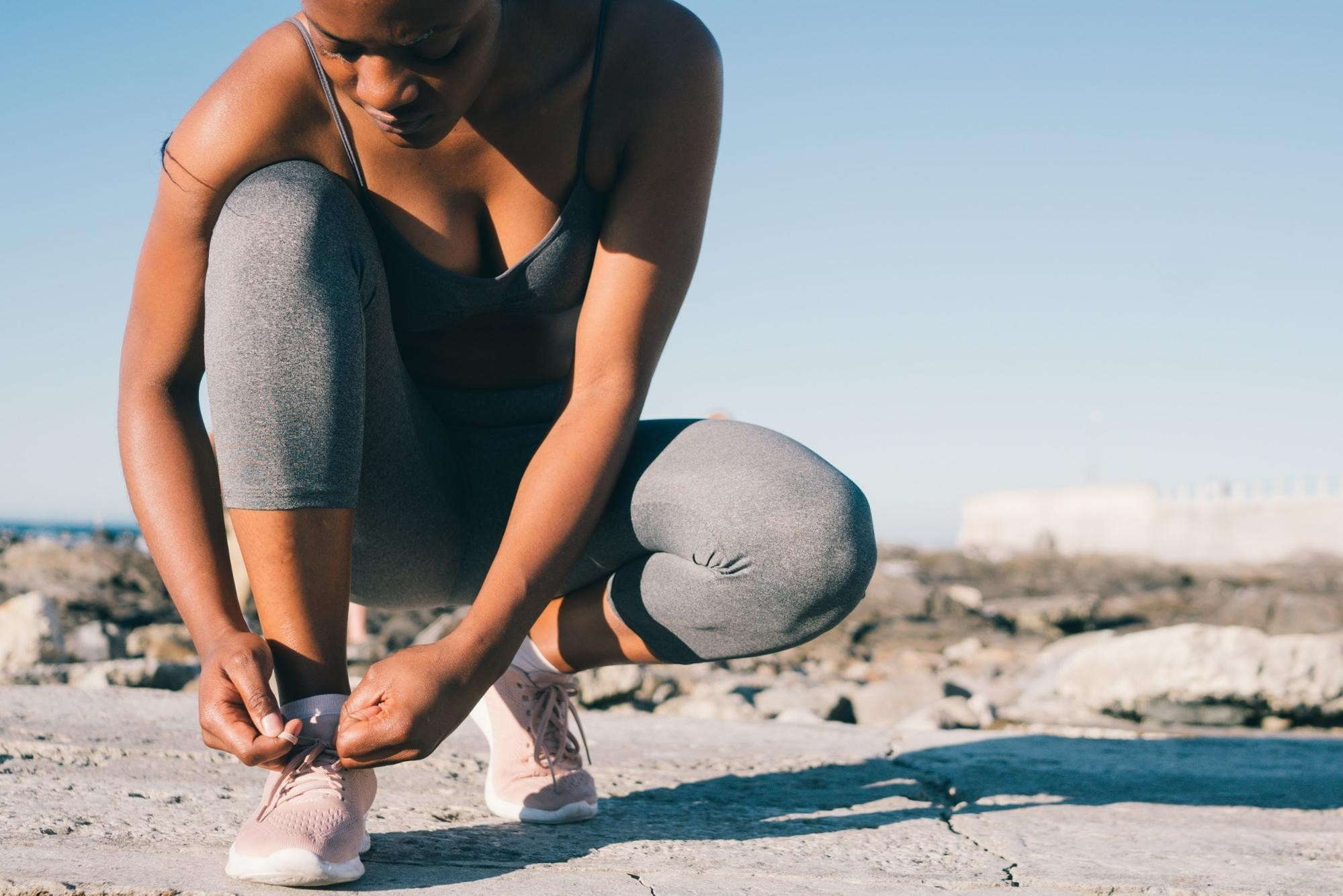 Athletic woman tying shoes