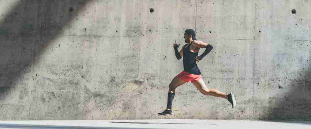 A man running after taking his carnitine supplement.