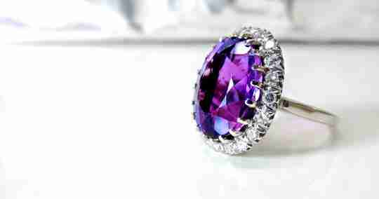 A ring with a purple gemstone
