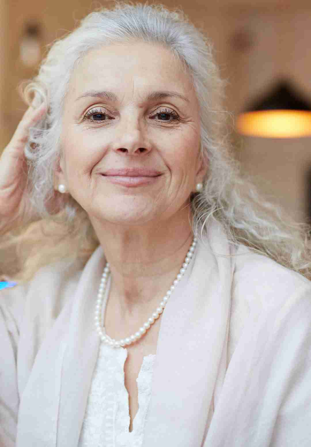 a gorgeous mature woman, with silver, full-bodied hair