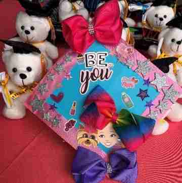 A graduation gift with bears, bows and a collage.