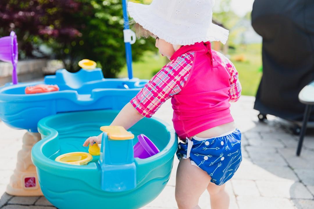 Baby girl wearing reusable swim diaper