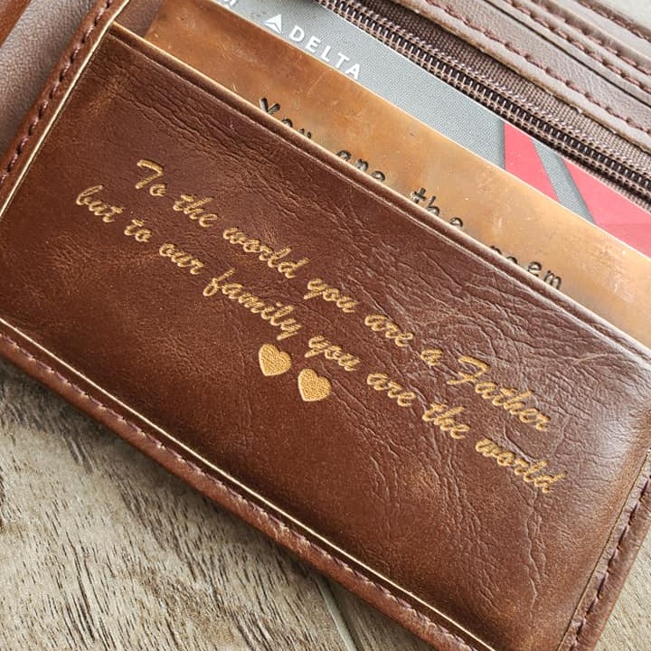 A brown leather wallet | leather wallet | leather wallet on which a message is engraved