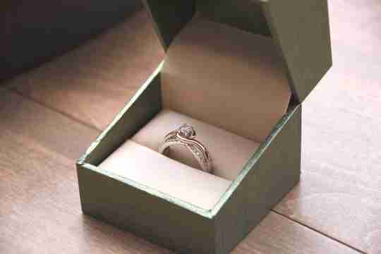A two-tone engagement ring in a box