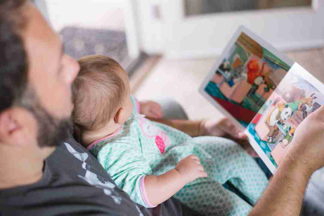 Dad reading to kid