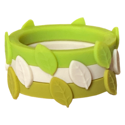 Limon ivory and grasshopper colored leaf silicone rings in the spring clover ring bundle.