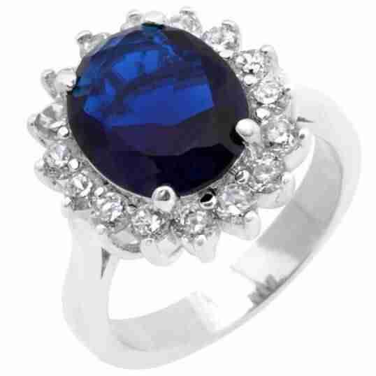 blu gemstone on silver metal