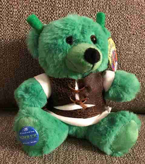 A green bear in a vest