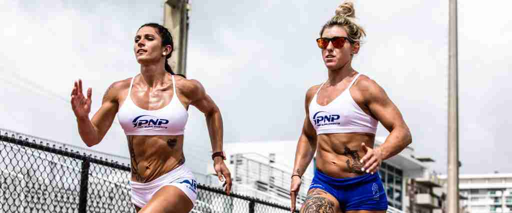 Two female CrossFit athletes running to improve their VO2 Max for CrossFit.