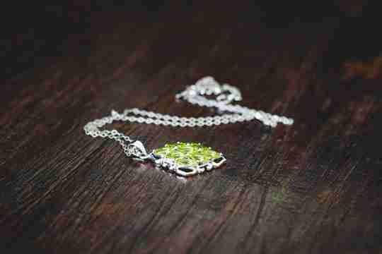 A necklace with a green gem