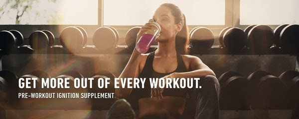 Get More Out of Every Workout Pre-Workout Ignition Supplement Woman Sitting Drinking in Gym