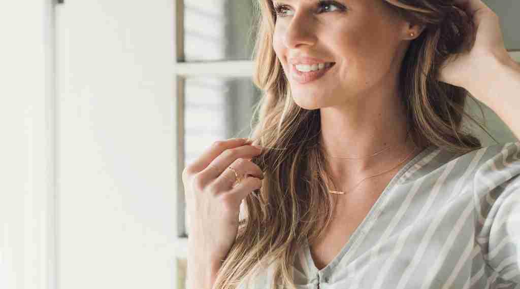 Woman wearing HONEYCAT jewelry