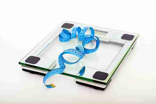 scale with a measuring tape weight loss
