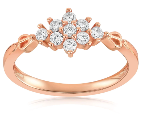 A rose gold vermeil ring with small gems pronged together, acting as the center stone